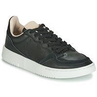 Scarpe Unisex bambino Sneakers basse adidas Originals SUPERCOURT J Nero