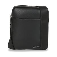 Sacs Homme Pochettes / Sacoches Calvin Klein Jeans CK BOMBE' FLAT CROSSOVER Noir