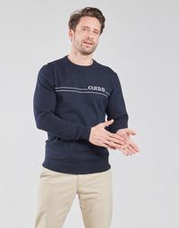 Kleidung Herren Pullover Guess LS CN LOGO 12 GG Marineblau